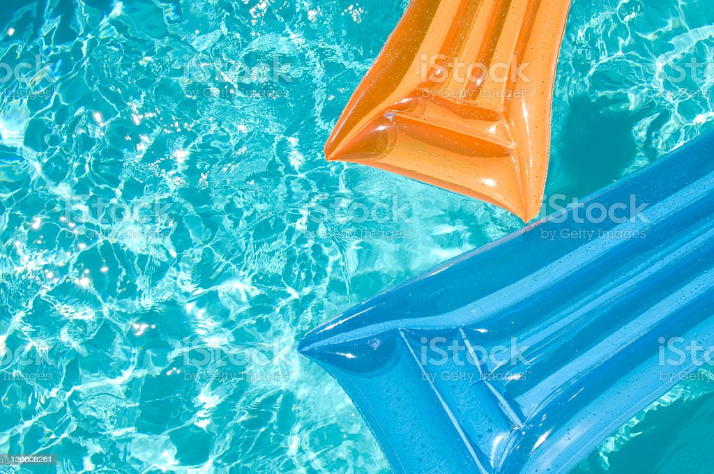 Inflatable Air Beds in Swimming Pool stock photo