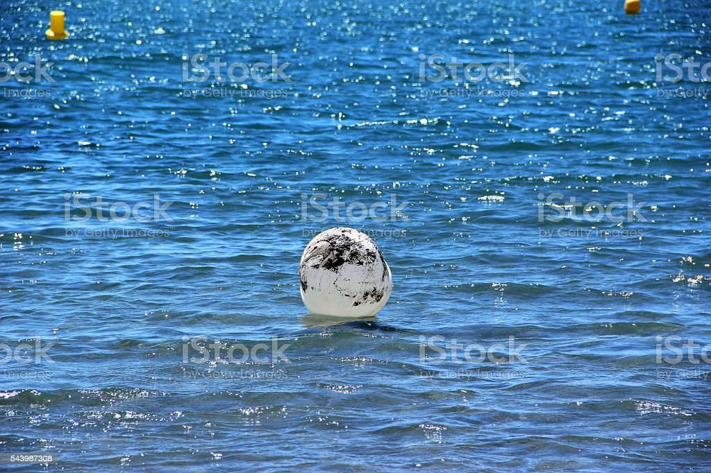 Inflatable ball in water stock photo