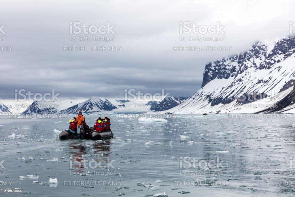 Inflatable boat in Burgerbukta Fjord, Hornsund, Spitsbergen, Norway stock photo