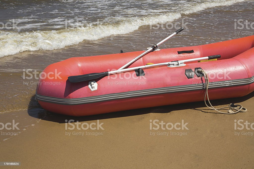 Inflatable boat on beach royalty-free stock photo