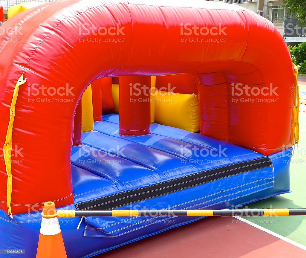 Inflatable bouncy castle in school stock photo