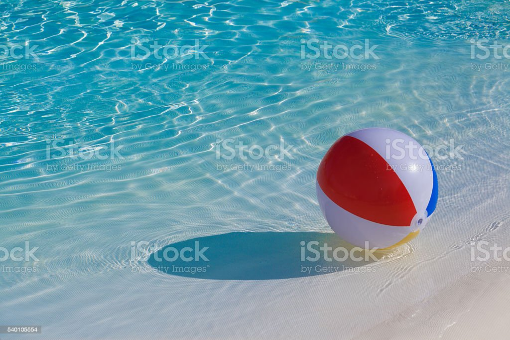 Inflatable colorful ball floating stock photo