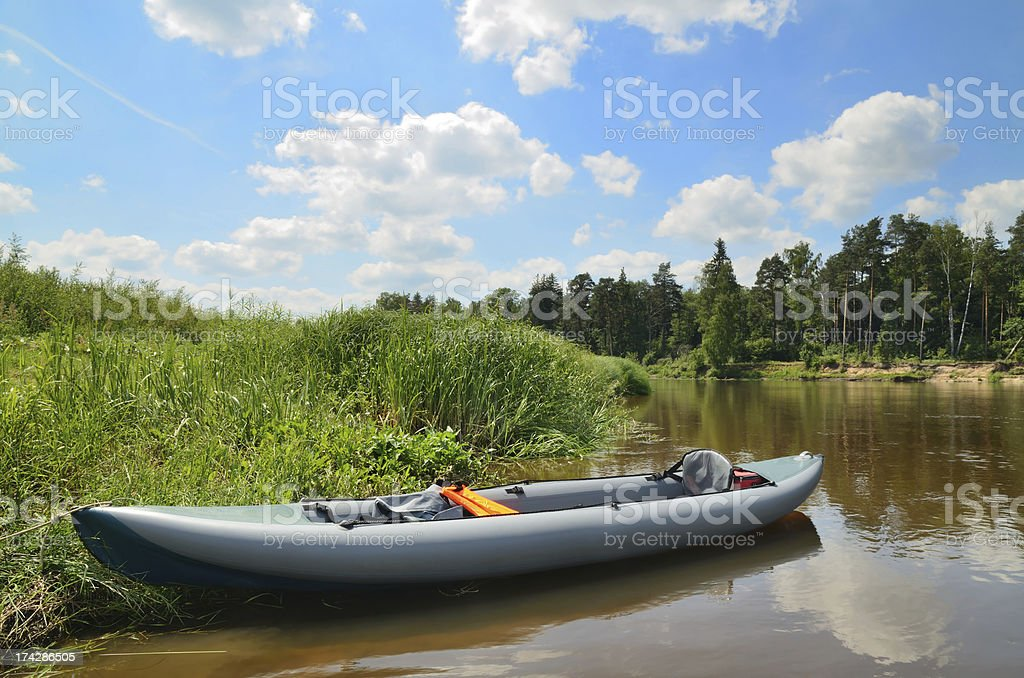 Inflatable kayak on the river royalty-free stock photo