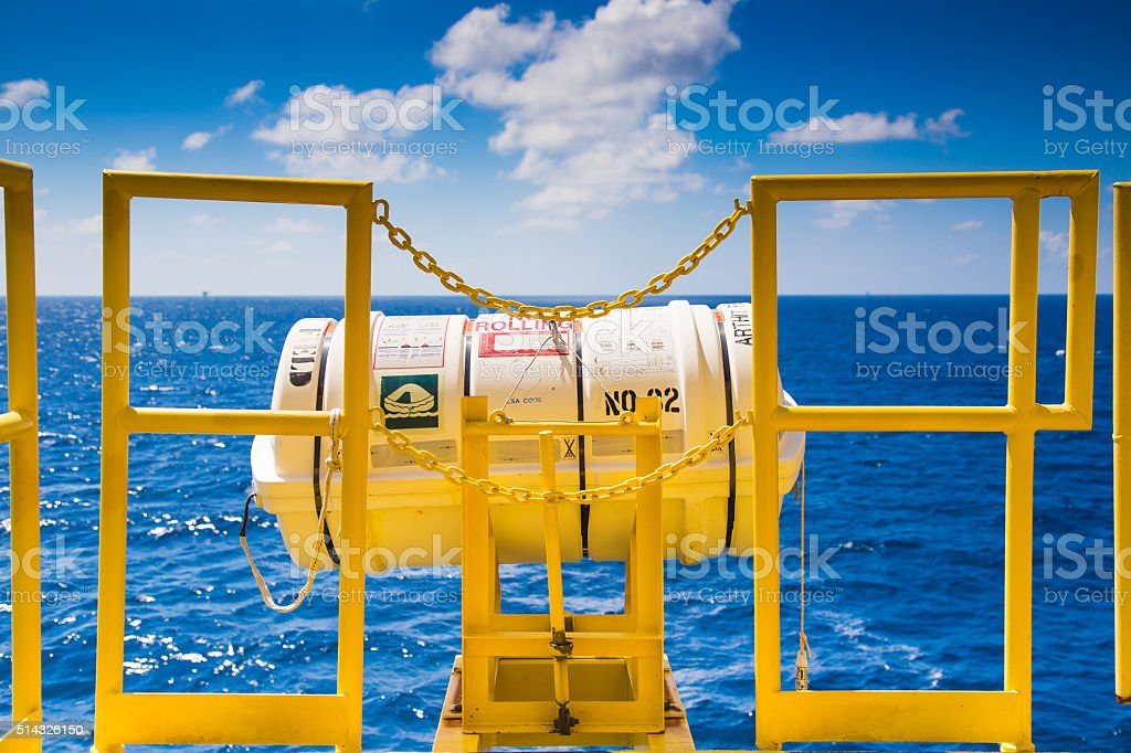 Inflatable life raft for rig,oil and gas platform. stock photo