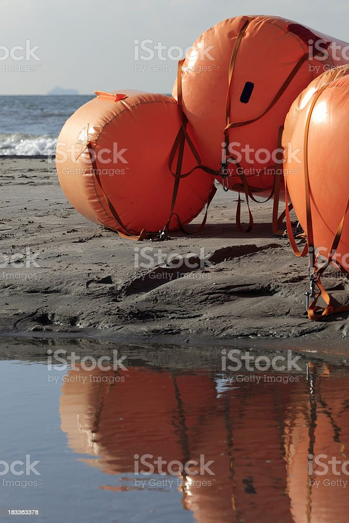inflatable nautical buoys on the beach royalty-free stock photo