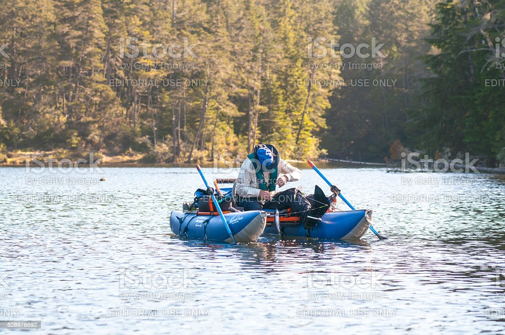 Inflatable Pontoon Boat with Man Trout Fishing on Cleawox Lake stock photo