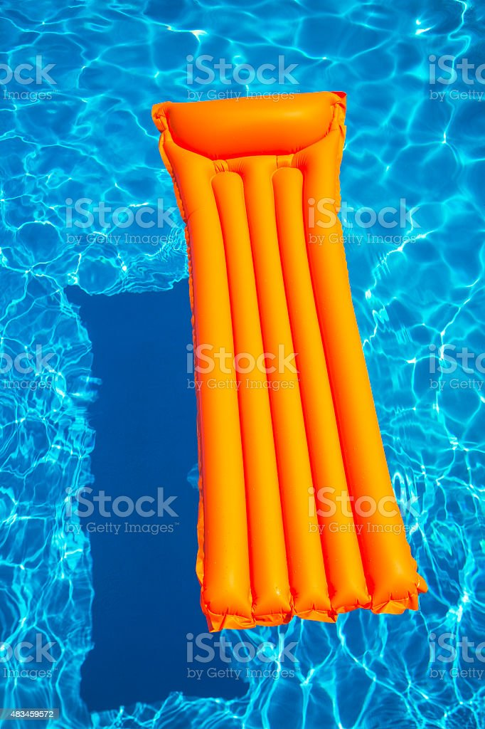 inflatable raft on pool stock photo