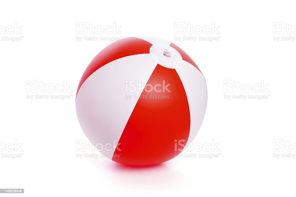 Inflatable red and white beach ball amongst white background stock photo