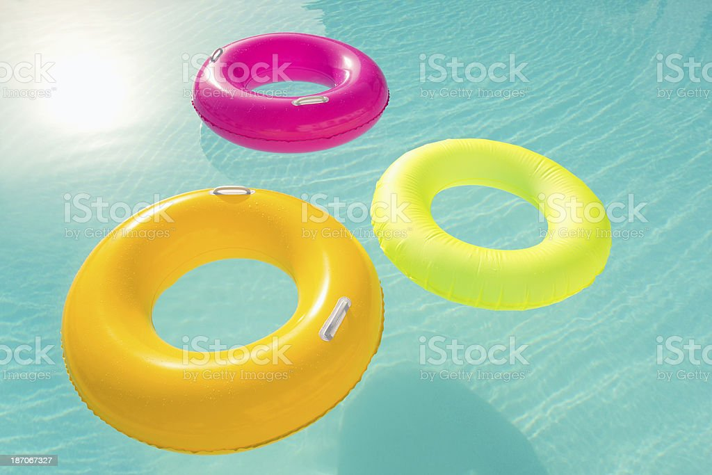 Inflatable Rings Floating In Resort Pool stock photo