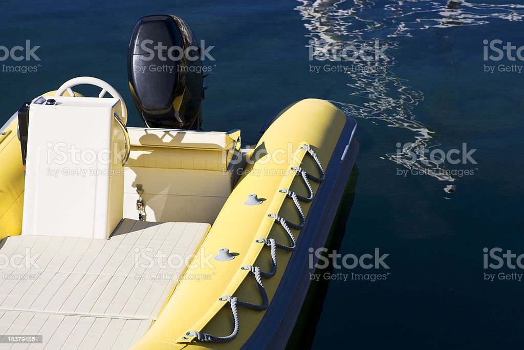 Inflatable rubber boat with outboard motor. royalty-free stock photo