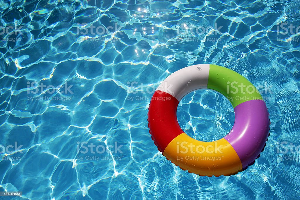 Inflatable Rubber Ring in a beautiful blue pool stock photo
