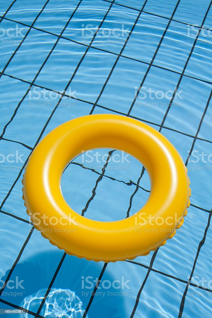Inflatable rubber ring in swimming pool stock photo