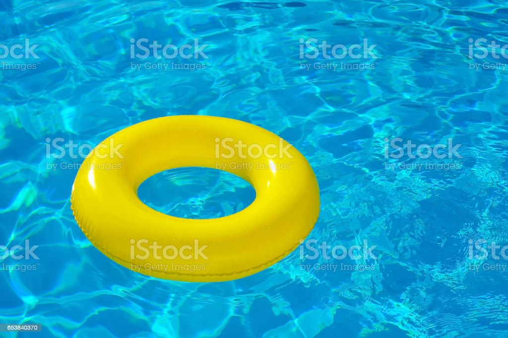 Inflatable tube floating in swimming pool stock photo