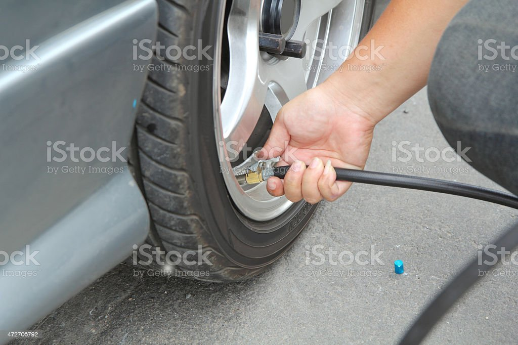 Inflate tires stock photo