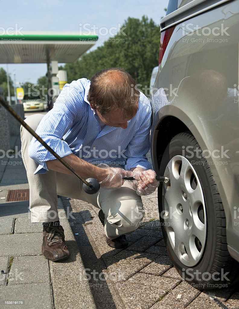 Inflating a tire royalty-free stock photo