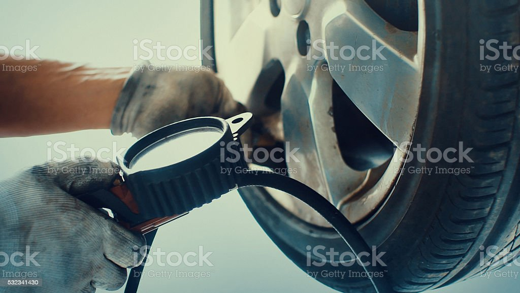 Inflating car tire. stock photo