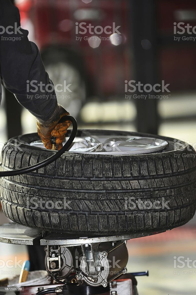 Inflating car tires royalty-free stock photo