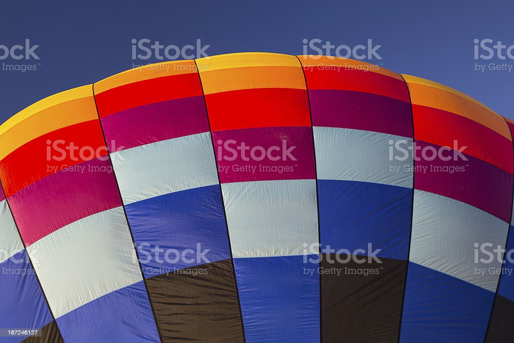 Inflating Multicolor Hot Air Balloon royalty-free stock photo