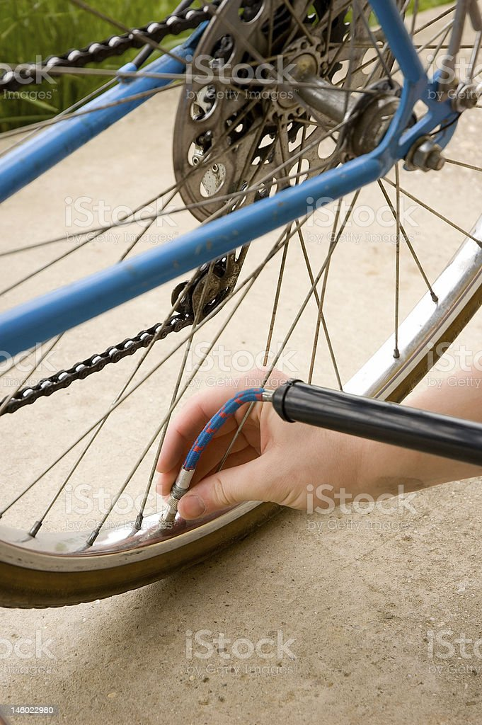 Inflating the tire of a bicycle royalty-free stock photo