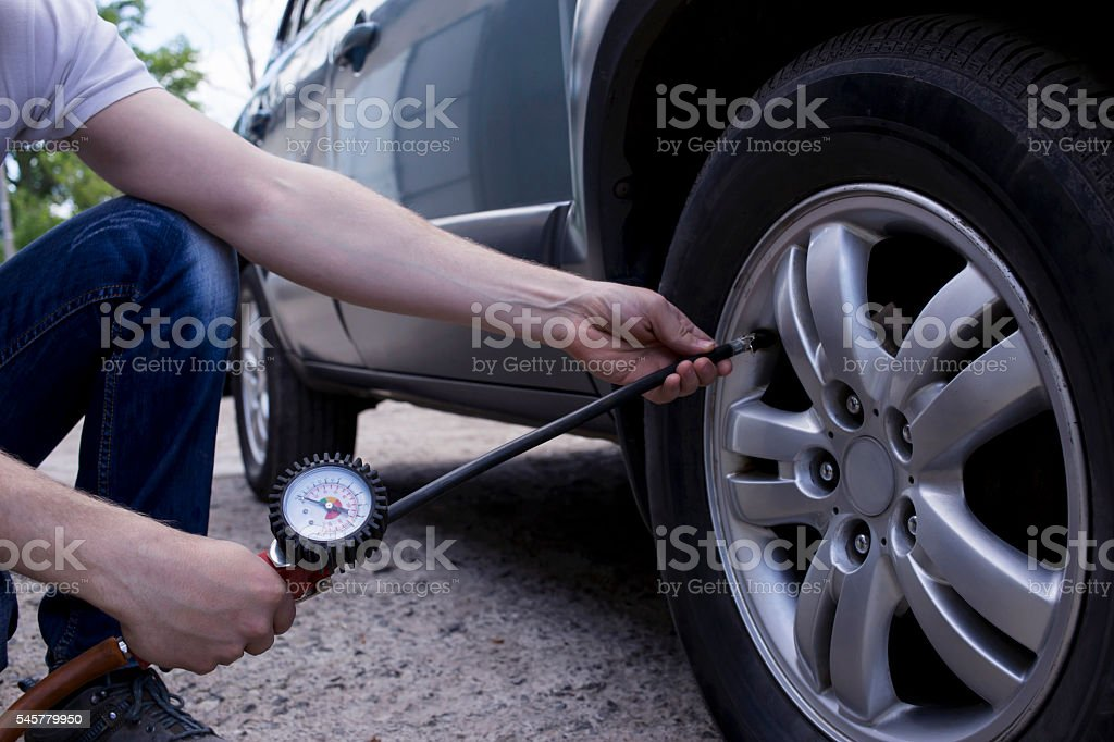 inflating the wheels stock photo