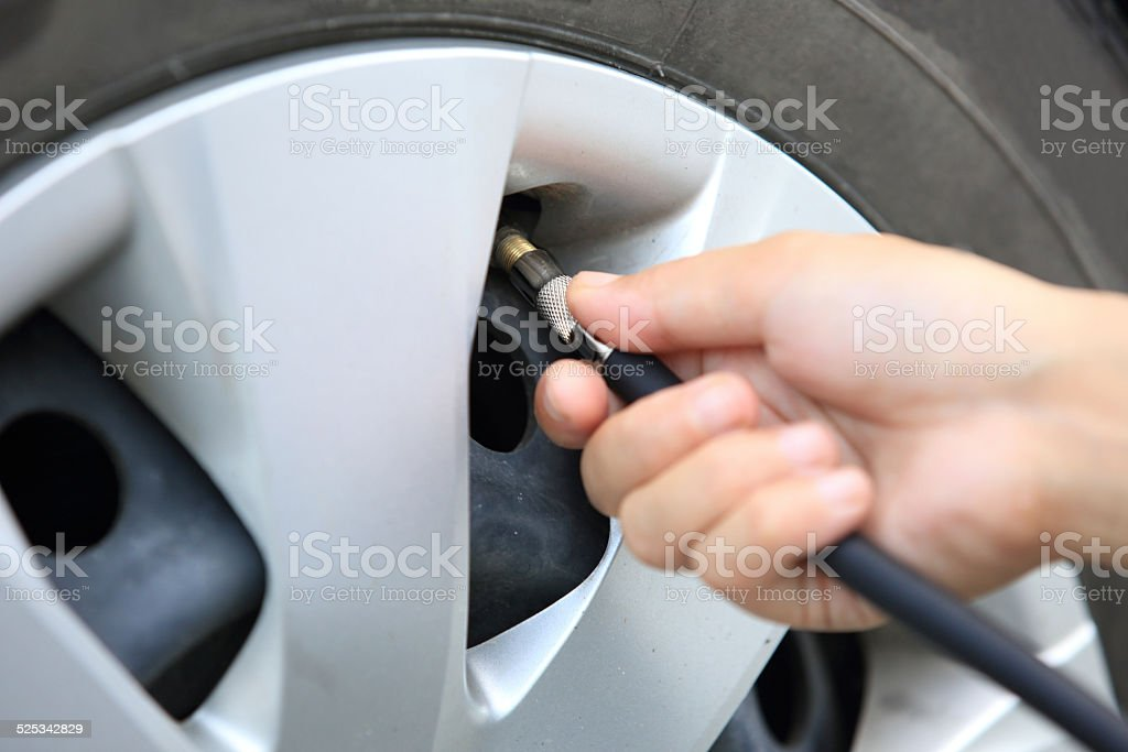 inflating tyre of car stock photo