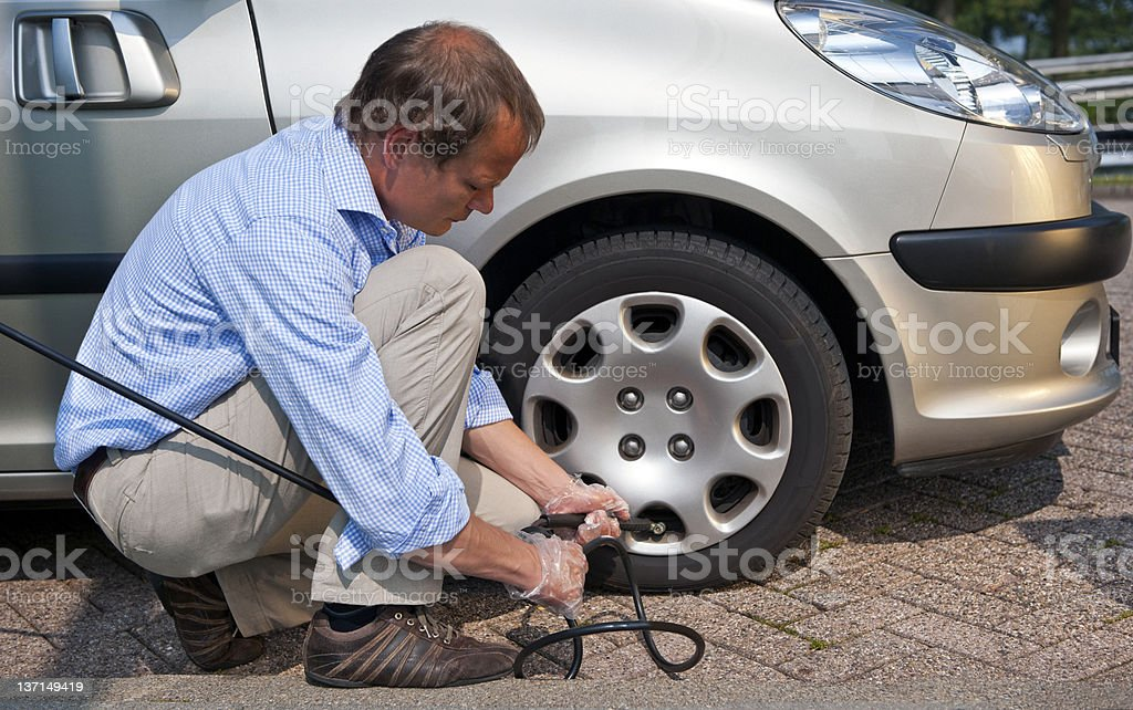 Inflating tyre stock photo