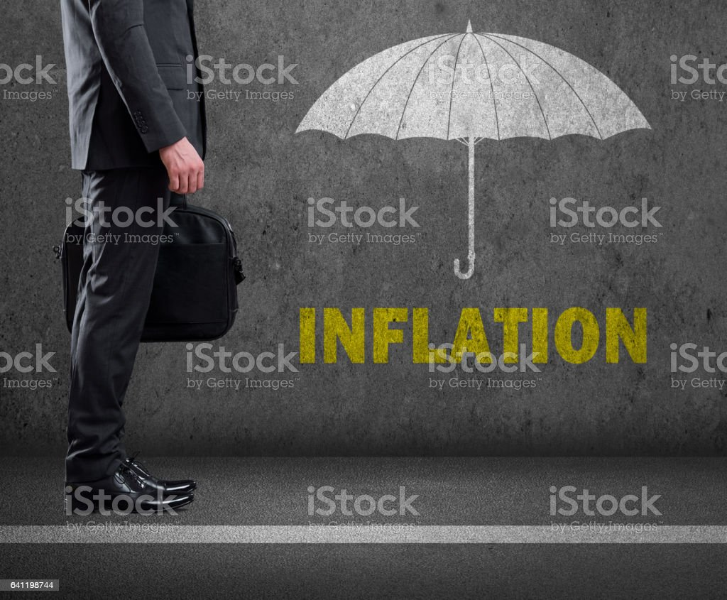 Inflation text on wall stock photo