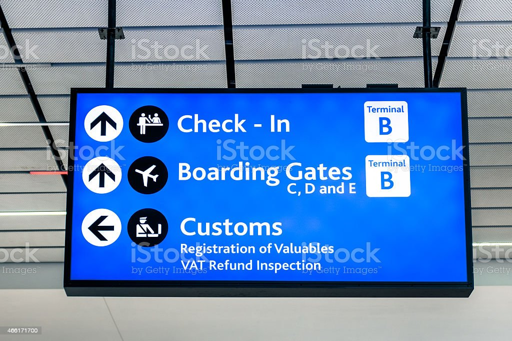 Info sign at international airport - Directions for check in stock photo