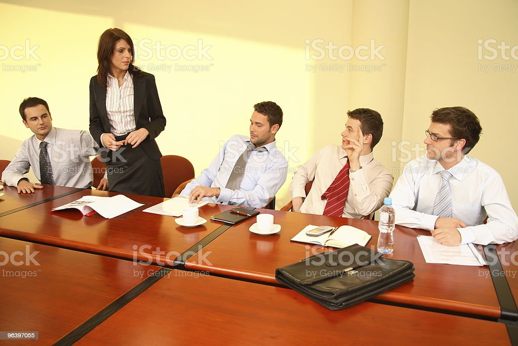 Informal business meeting - woman boss speech stock photo