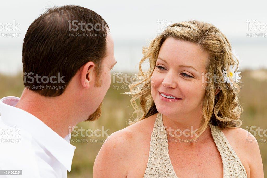 Informal photograh of bride smiling at her husband. stock photo