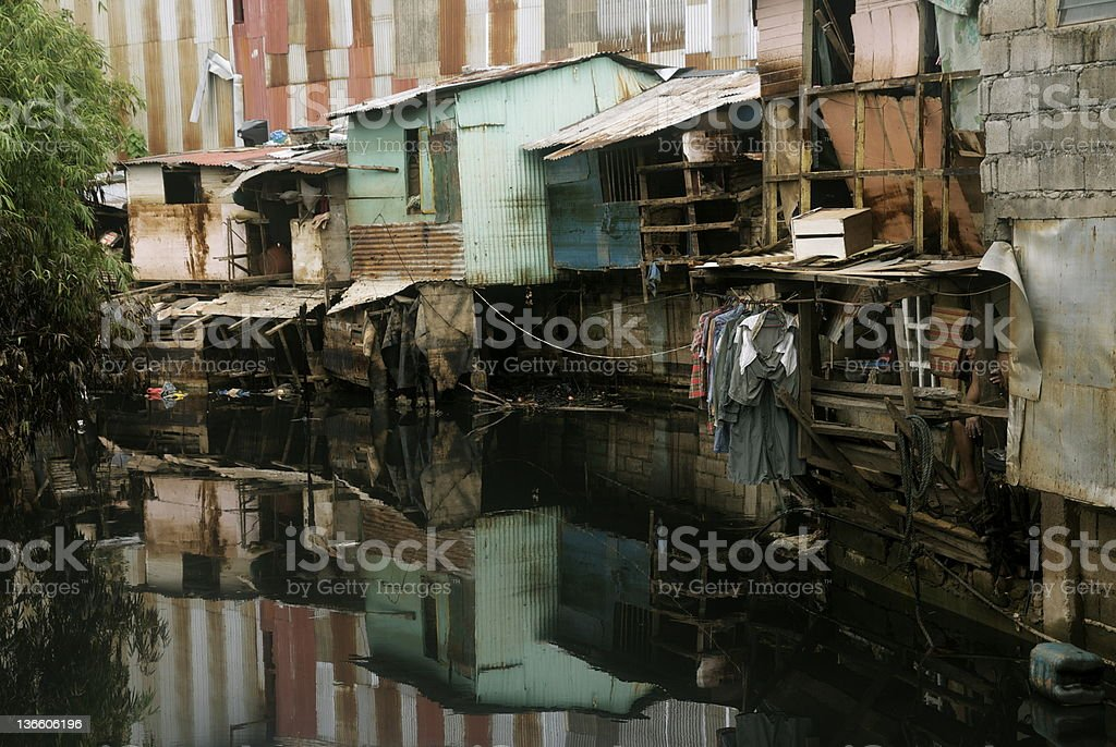 Informal settlers by the river stock photo