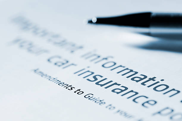 information for car insurance document with pen stock photo