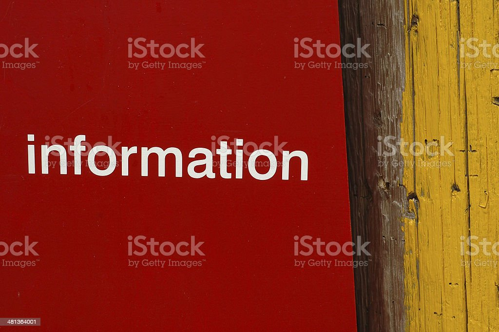 information text on red and yellow wooden background stock photo