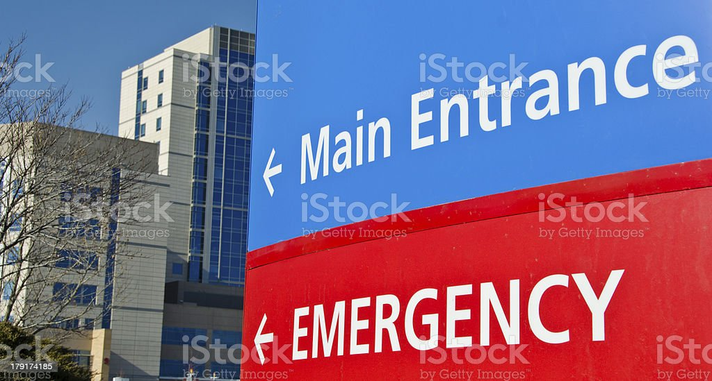 Informative sign at the entrance of hospital driveway stock photo