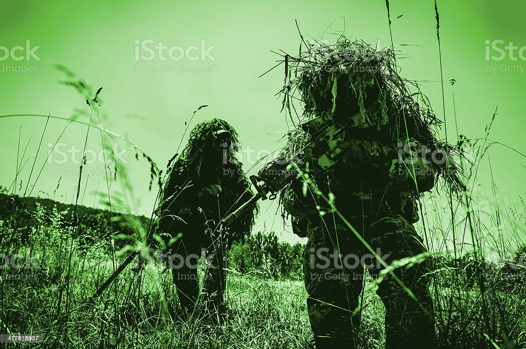 Infrared Night Shot of Sniper and Spotter Soldiers Hiding stock photo