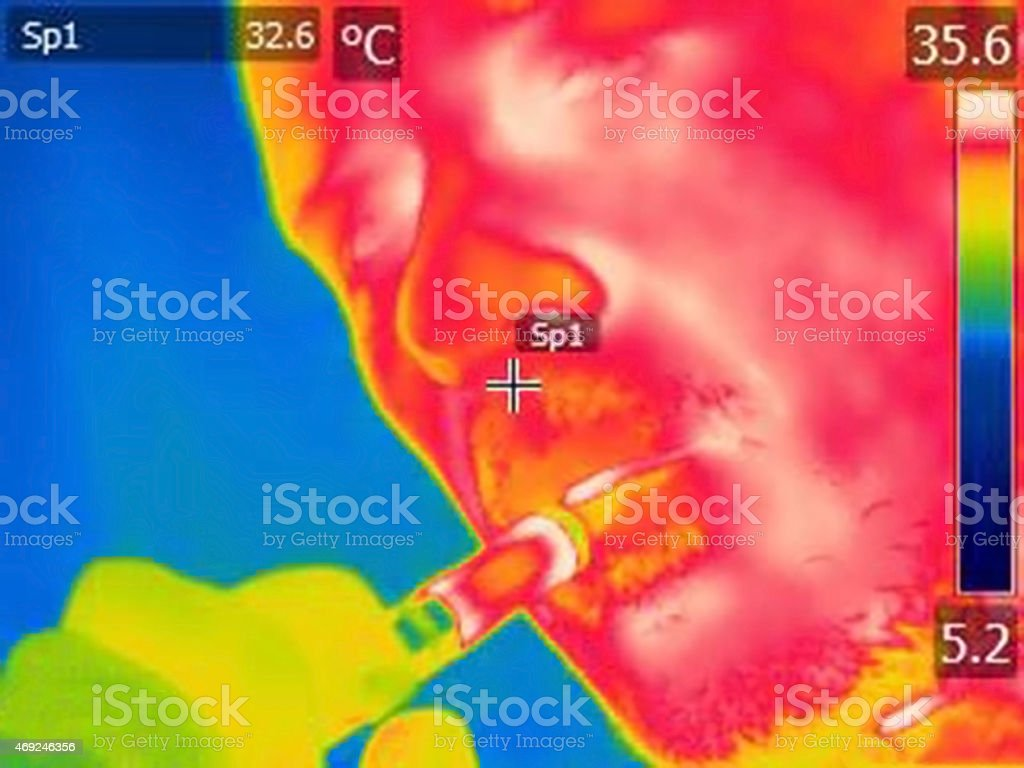 infrared thermal image of a man vaping e cigarette stock photo