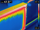 Infrared thermal image of heat emission from home radiator