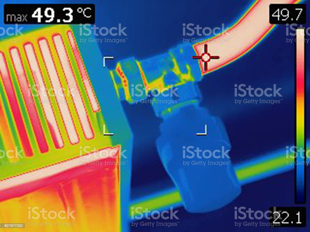 Infrared thermal image of home radiator valve stock photo