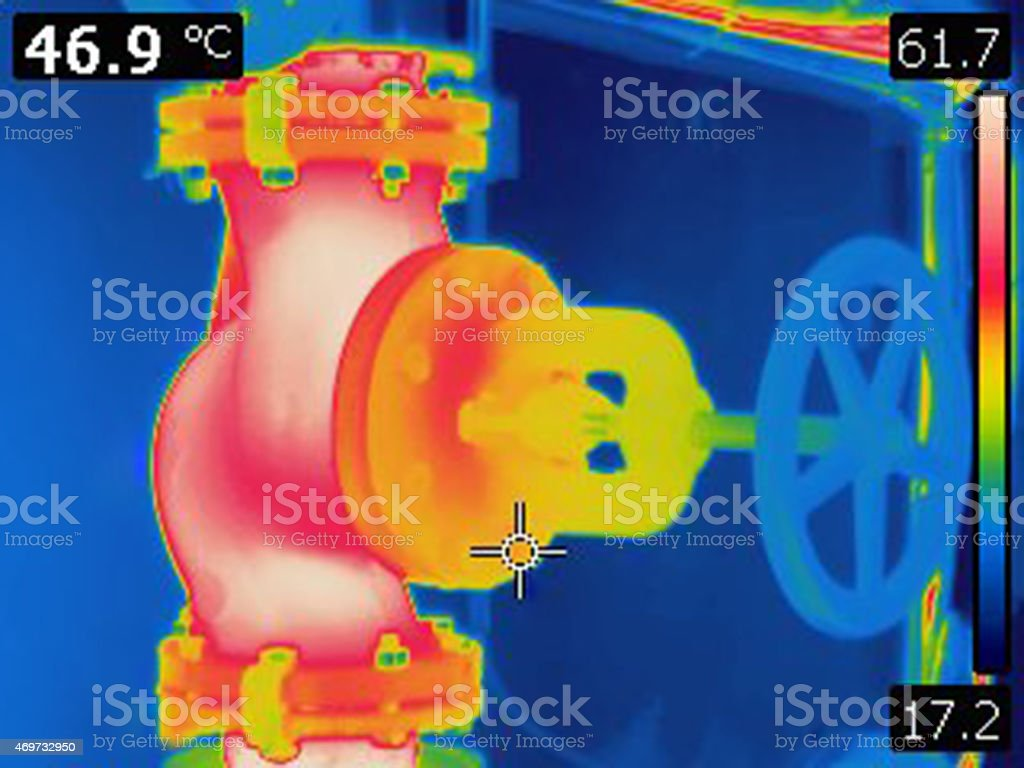 infrared thermal image of valve on heating pipeline stock photo