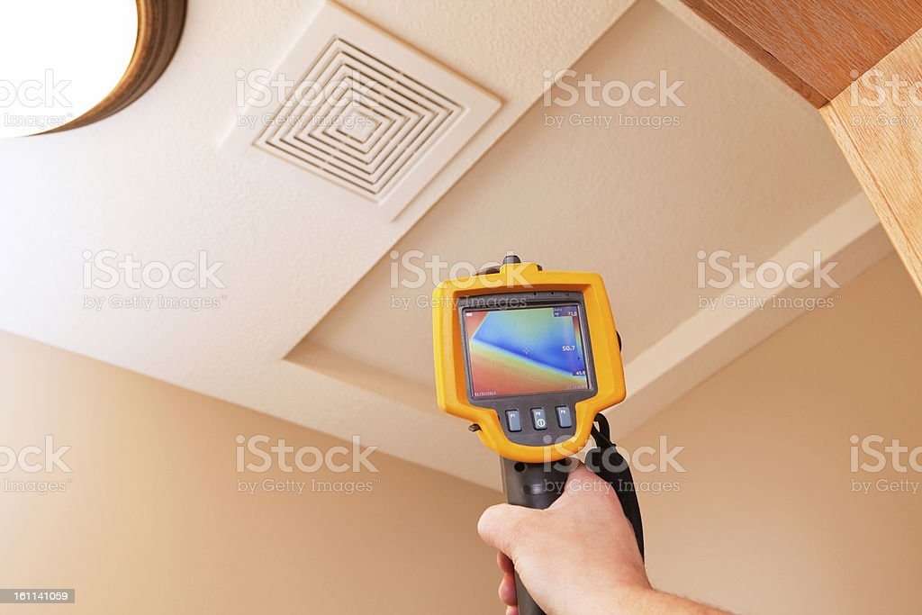 Infrared Thermal Imaging Camera Pointing to Attic Access stock photo