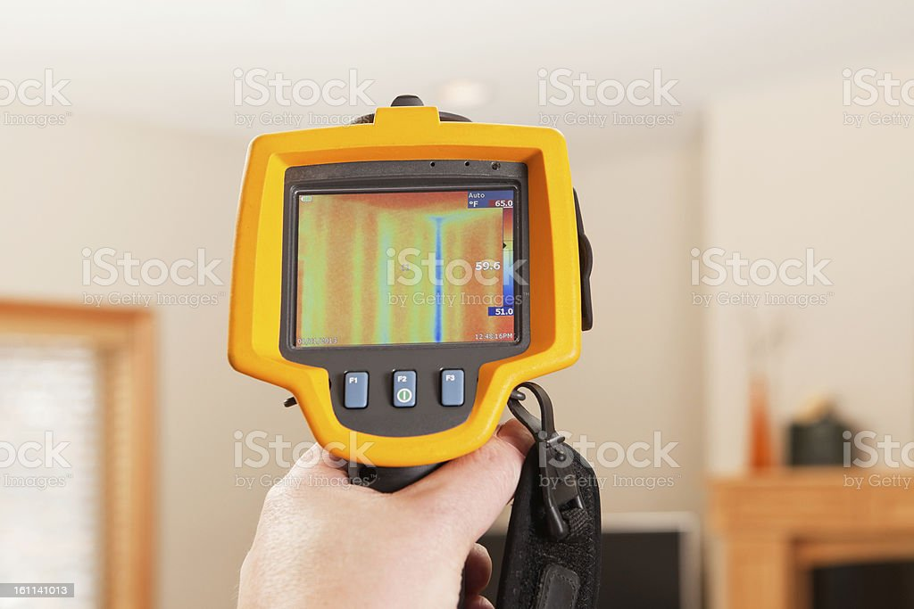 Infrared Thermal Imaging Camera Pointing to House Wall stock photo