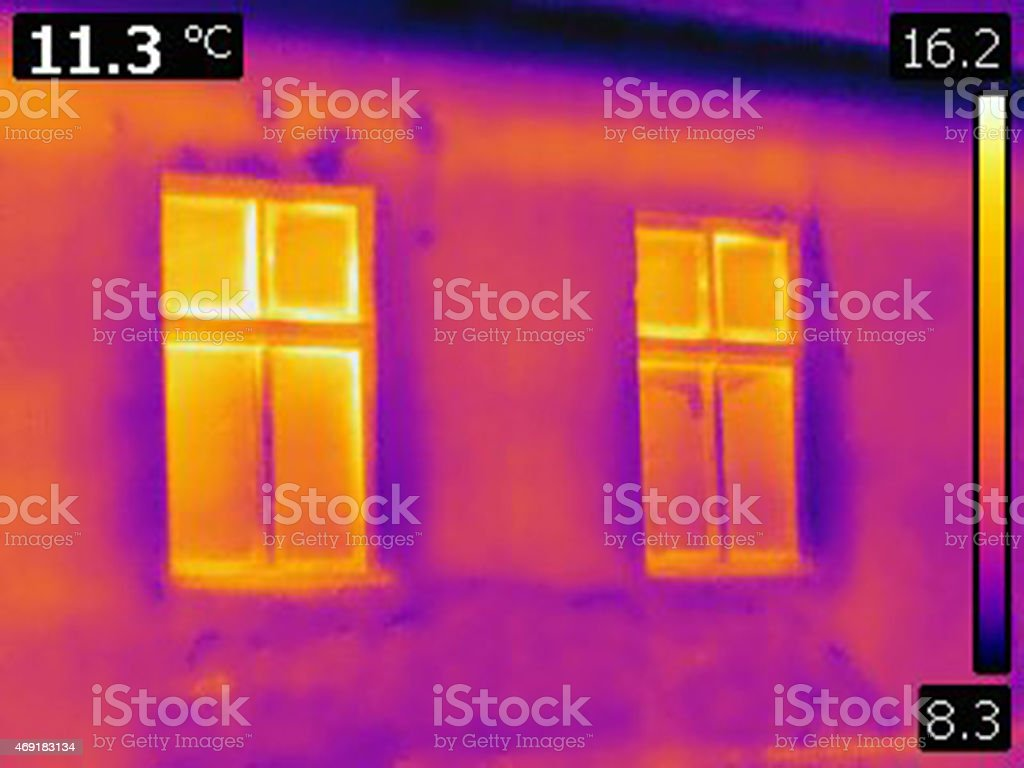 infrared thermal photo of house outer wall with two windows stock photo