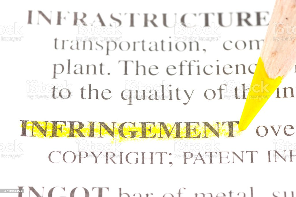 infringement definition highligted in dictionary royalty-free stock photo