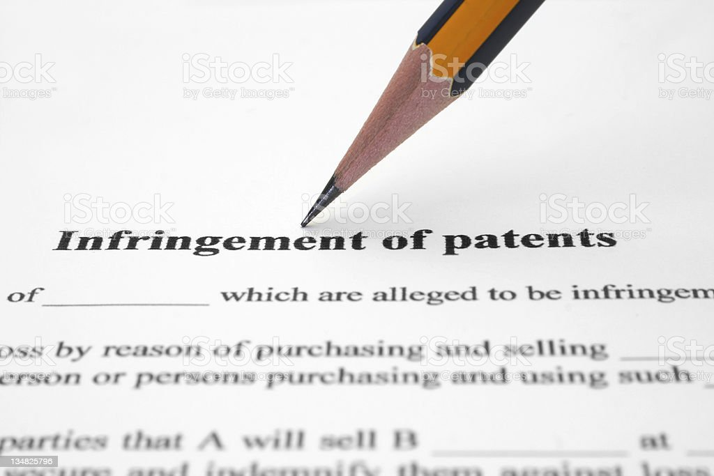 Infringement of patents royalty-free stock photo