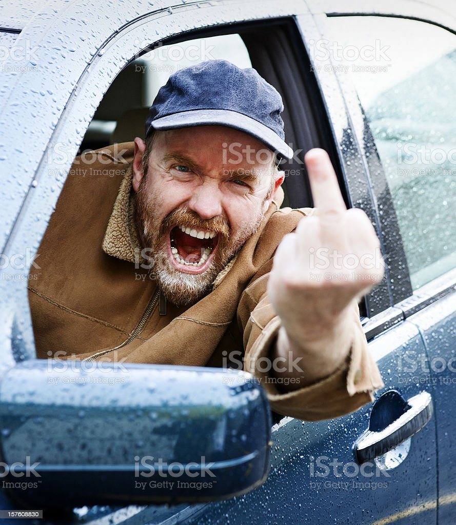 Infuriated driver gestures rudely and yells royalty-free stock photo