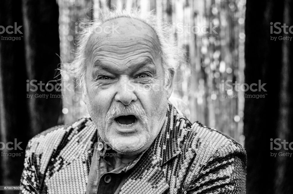 Infuriated man shouting at the camera stock photo