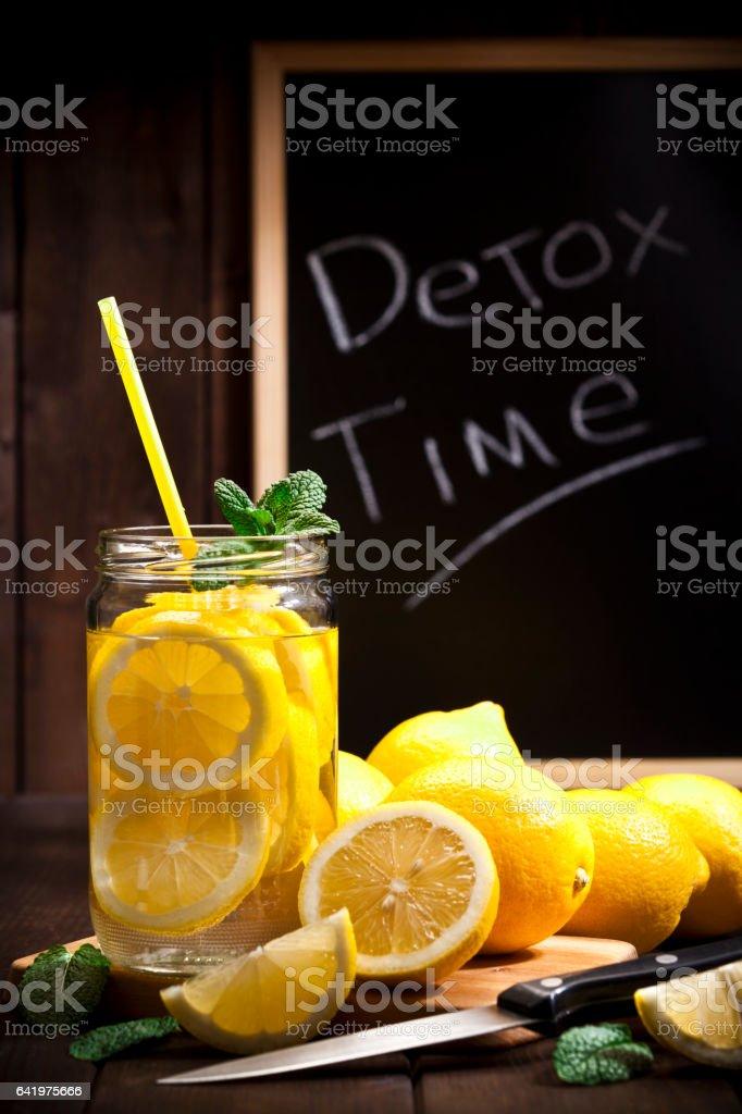 Infused lemon water detox drink stock photo