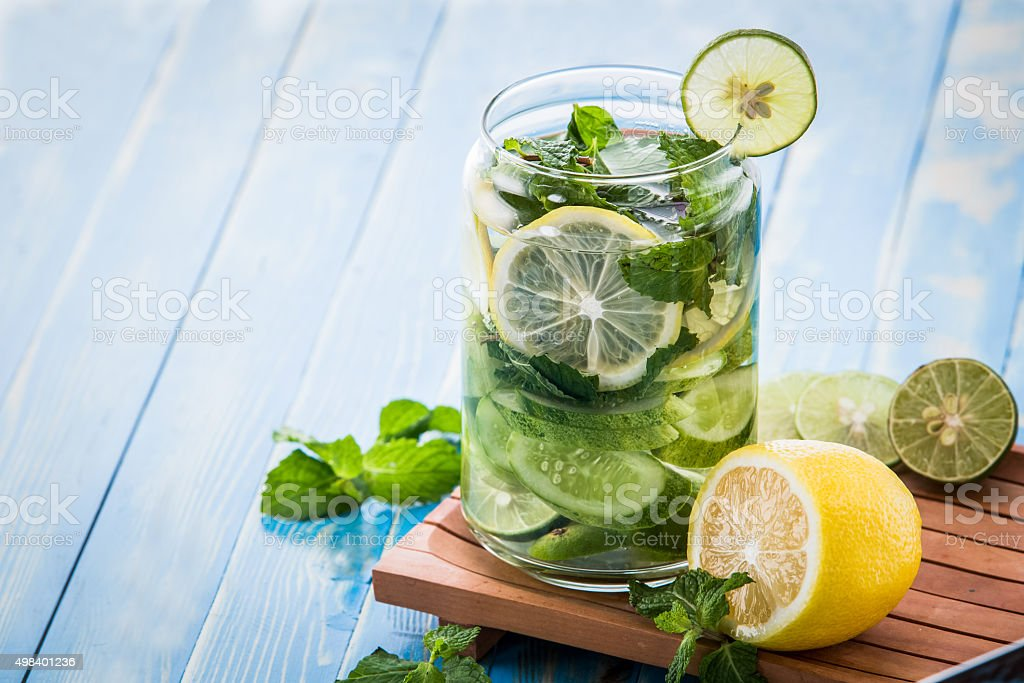 infused water mix of cucumber, lemon and mint leaf stock photo