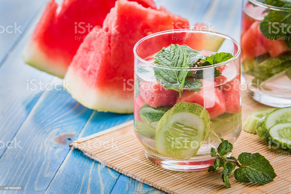 infused water mix of cucumber, watermelon and mint leaf stock photo