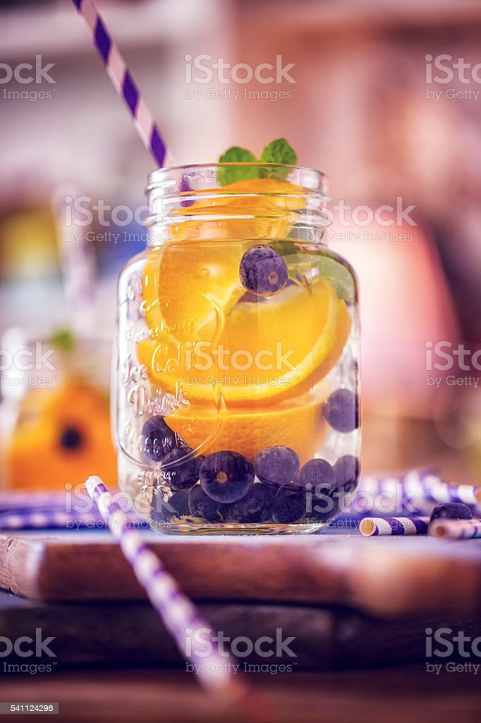 Infused Water with Fresh Blueberries and Oranges stock photo